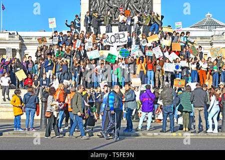 Group of teenage student boys & girls & school children kids miss school to strike protest on climate change wave placards & chant London England UK - Stock Image
