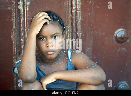 Portrait of a Cuban girl with flakes of polystyrene confetti in her her. Havana, Cuba - Stock Image