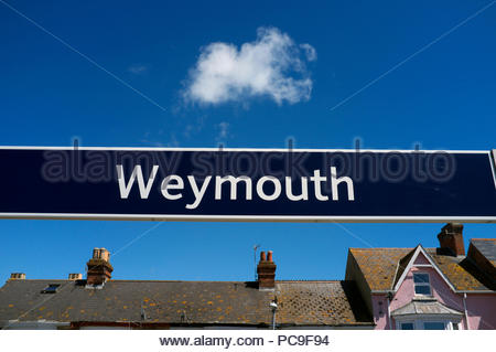 Weymouth - place name sign at the railway station at the popular seaside holiday resort in Dorset, UK. - Stock Image