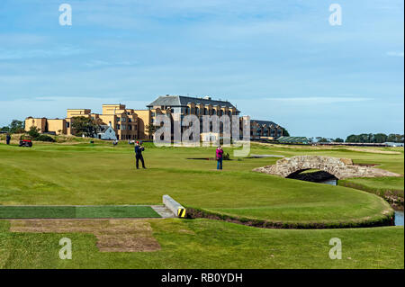 Swilken bridge on the old course at St Andrews Fife Scotland UK with the Old Course Hotel in the background - Stock Image