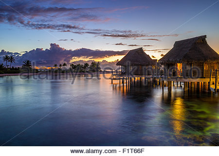 French Polynesia : Tikehau Pearl Beach water bungalows at sunset - Stock Image