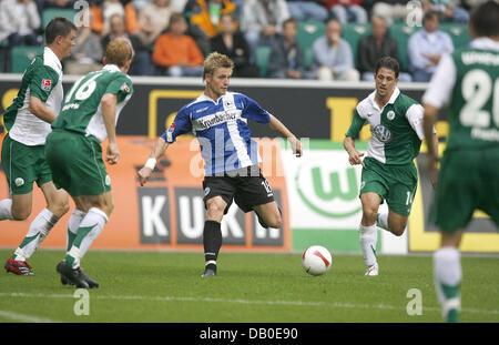 Artur Wichniarek (C) of Wolfsburg aims to score during the Bundesliga match VfL Wolfsburg v Arminia Bielefeld at - Stock Image