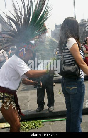 Aztec Shaman Performing a Spiritual Cleansing Ritual on a Female Tourist, Zocalo Square, Plaza de la Constitucion, - Stock Image