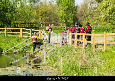 Members of Greater Manchester Fire and Rescue Service undertaking water rescue training at Burrs Activity Centre, Burrs Country Park, Bury. - Stock Image