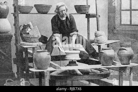 Man making pottery (Breton Faience) at Quimper, Brittany, Northern France. - Stock Image