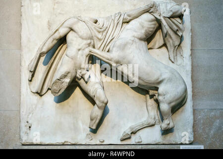 Part of the Elgin Marbles in the British Museum, London, UK. South Metope VII. Lapith and Centaur fighting - Stock Image