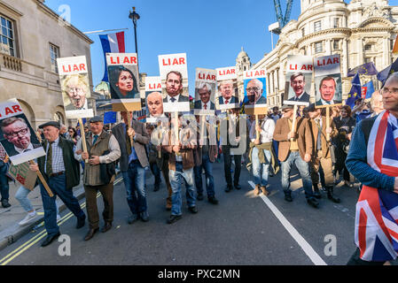 London, UK. 20th October 2018. Marchers come down Whitheall carrying posters of leading Brexiteers with the word 'LIAR' above their faces at the end of the People's Vote March calling for a vote to give the final say on the Brexit deal or failure to get a deal. They say the new evidence which has come out since the referendum makes it essential to get a new mandate from the people to leave the EU. With so many on the march the crowding meant many failed to reach Parliament Square and came to a halt in Whitehall. Peter Marshall/Alamy Live News - Stock Image