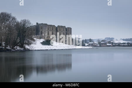 Pembrokeshire, Wales, 2nd March 2018. A rare snow filled scene at Carew Castle & Tidal Mill in Pembrokeshire, - Stock Image