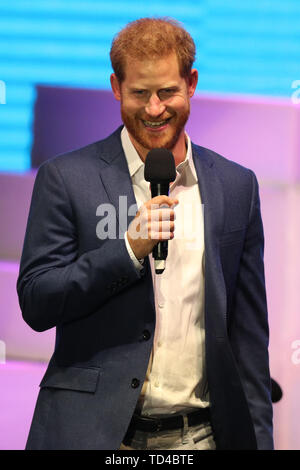 The Duke of Sussex on stage at a concert hosted by Sentebale in Hampton Court Palace in East Molesey, to raise awareness and vital funds for the Duke's charity, Sentebale, which helps young people in southern Africa affected by HIV. - Stock Image