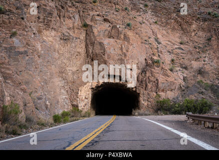 Rugged Tunnel Through Mountain - Stock Image