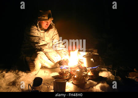 Corporal Charles Roy III, an optics technician assigned to The Combined Arms Company out of Bulgaria, uses small - Stock Image