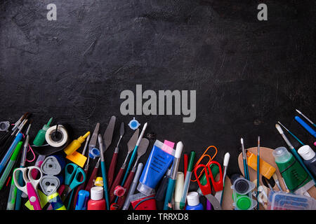 School supplies on blackboard background. Concept of education and study - Stock Image