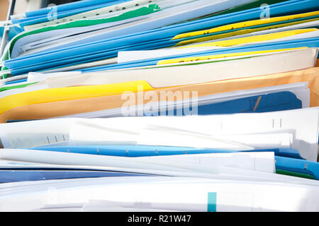 A messy drawer or cabinet with filed papers and documents sorted in folders - Stock Image