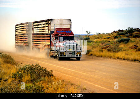 Livestock transport road train on dirt road, in outback Australia - Stock Image