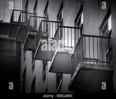 The balconies of a New York City apartment building create an interesting image when photographed from the street. - Stock Image