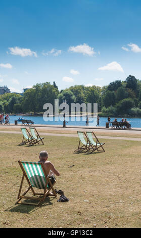 Deckchair in the park - Stock Image