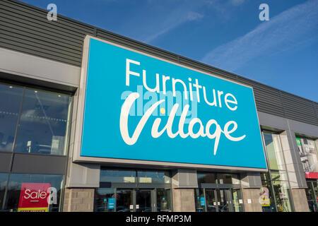 Furniture Village store sign. Sign outside a Furniture Village shop, Stevenage, UK - Stock Image