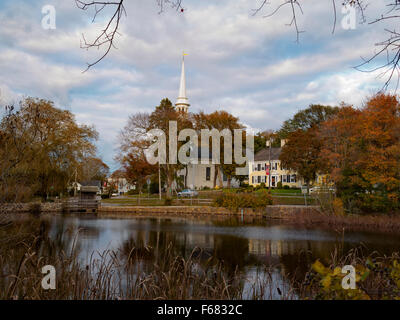 View of the small town of Sandwich Cape Cod Massachusetts framed by cattails across Shawme Pond with church steeple - Stock Image