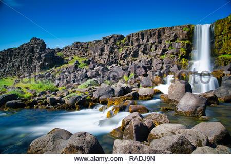 Öxarafoss Waterfall Öxarafoss waterfall in Iceland's Thingvellir natonal park, photographed during a sunny summer day. - Stock Image
