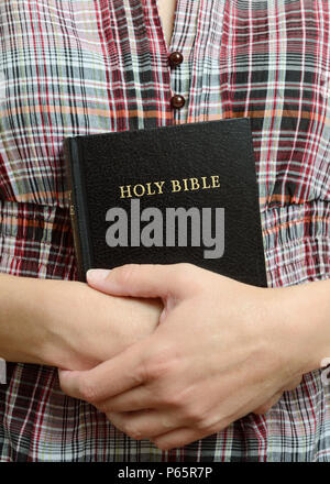 Young Woman Holding a Bible - Stock Image