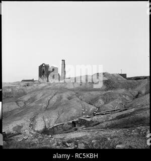 Cononley Lead Mine, Stockshott Lane, Cononley, Craven, North Yorkshire, 1966-1974. View of the lead works from the south-west with spoil heaps in the foreground. - Stock Image