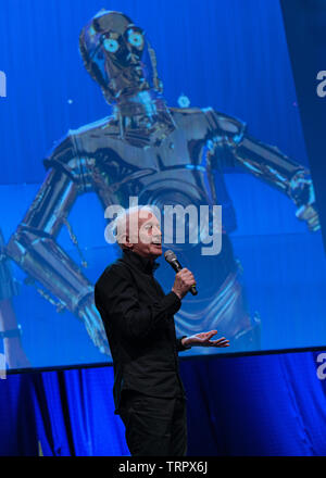 Bonn, Germany - June 8 2019: Anthony Daniels (*1946, English actor - C-3PO in Star Wars) talks about his experiences in Star Wars at FedCon 28 - Stock Image