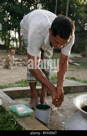 BANGLADESH Farid Pathang washing himself Garo tribal minority Haluaghat, Mymensingh region photo by Sean Sprague - Stock Image