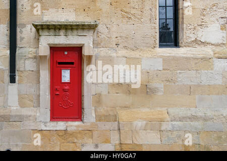 WINDSOR, UK - MARCH 18: A traditional iconic British post box in a stone wall in March 2017. - Stock Image