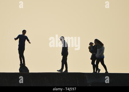 Aberystwyth Ceredigion Wales UK, Wednesday 17 April 2019. People enjoying a gloriously sunny and warm April spring evening with clear blue skies in Aberystwyth Wales, as the weather is set to improve as the country heads into the Easter Bank Holiday weekend photo Credit: Keith Morris/Alamy Live News - Stock Image