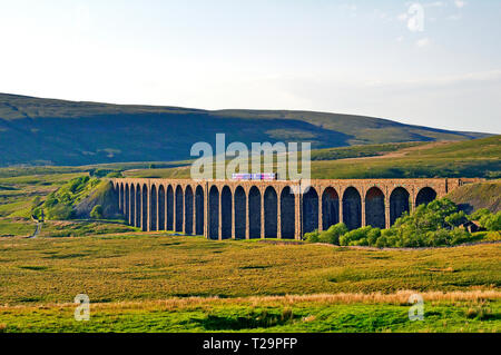 Train crossing the Ribblehead Viaduct over Batty Moss the Yorkshire Dales Railway England - Stock Image