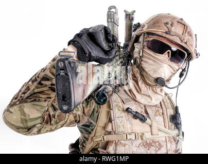 Special forces soldier in field uniform and face mask with sniper rifle on his shoulder - Stock Image