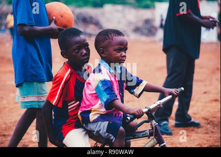 Mali, Africa - Black african children playing soccer in a rubbish dump. Rural area near Bamako - Stock Image