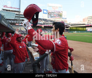 Los Angeles Angels' designated hitter Shohei Ohtani celebrates with teammates in the dugout after hitting a two-run home run in the third inning during the Major League Baseball game against the Minnesota Twins at Oriole Park at Target Field in Minneapolis, Minnesota, United States, May 13, 2019. Credit: AFLO/Alamy Live News - Stock Image