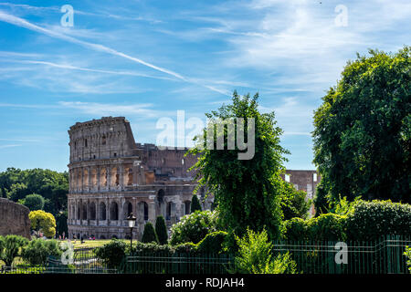 Rome, Italy - 24 June 2018: Facade of the Great Roman Colosseum (Coliseum, Colosseo), also known as the Flavian Amphitheatre. Famous world landmark - Stock Image