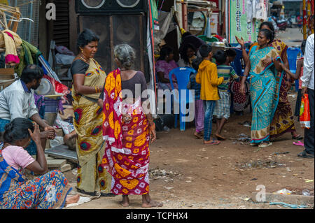 Poverty in India, where shoppers go about their everyday lives in George Town, a district if Chennai - Stock Image