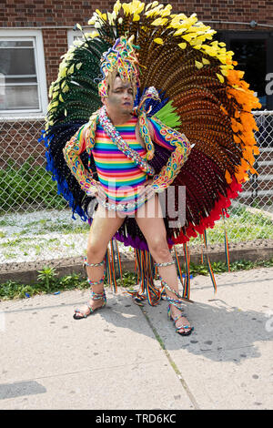 Posed portrait of a marcher in an elaborate peacock costume at the 2019 Queens Pride Parade in Jackson Heights, NYC. - Stock Image