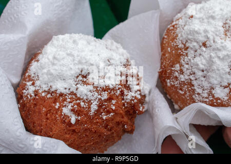 Quarkballchen, deep-fried German pastries made with quark cheese. Commonly found at Christmas markets and other street vendors. - Stock Image
