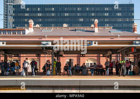 Commuters waiting at Roma Street Station, Brisbane, Queensland, Australia - Stock Image