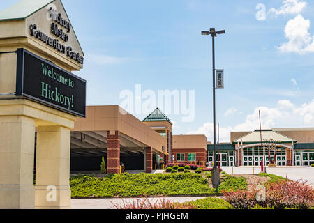 HICKORY, NC, USA-9/6/18: The Hickory Metro Convention Center, showing street sign, main building on right, and parking deck to left. - Stock Image