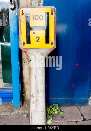 A British H for fire hydrant sign. - Stock Image