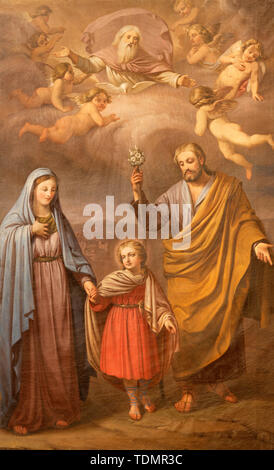 CATANIA, ITALY - APRIL 8, 2018: The painting of Holy Family in the church Chiesa di Sant'Agata la Vetere from end of 19. cent. - Stock Image