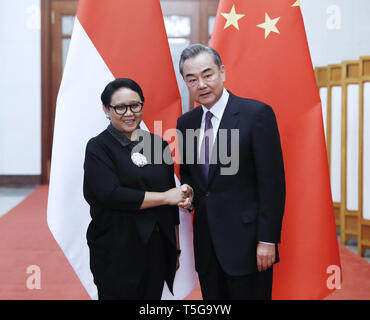 Beijing, China. 24th Apr, 2019. Chinese State Councilor and Foreign Minister Wang Yi (R) meets with Indonesian Foreign Minister Retno Marsudi in Beijing, capital of China, April 24, 2019. Credit: Liu Bin/Xinhua/Alamy Live News - Stock Image