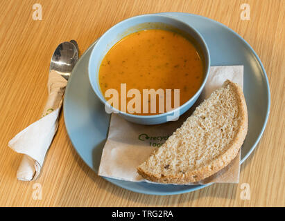 Vegetarian soup with brown bread and recyclable napkins, Scotland, UK - Stock Image