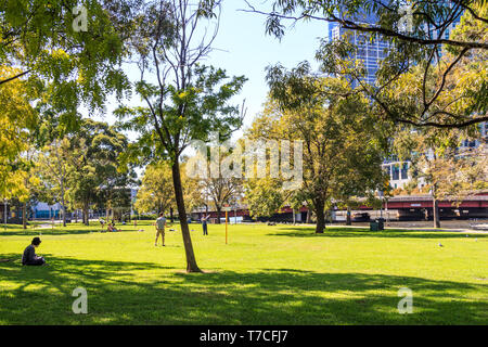 Melbourne, Australia - 20th March 2013: People enjoying the sunshine in Batman Park. The park is on the banks of the River Yarra. - Stock Image