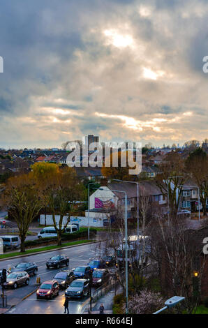 Traffic in Romford, Essex below a stormy, cloudy sky. - Stock Image