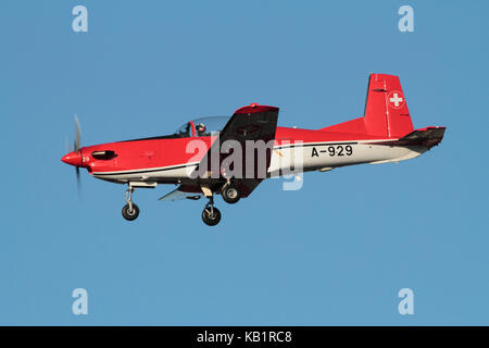 A Pilatus PC-7 aircraft of the Swiss Air Force PC-7 display team on approach for landing - Stock Image
