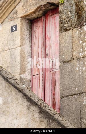 village house and door in Tourem - Stock Image