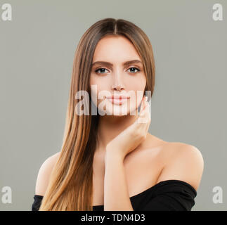Cheerful model woman with brown hair portrait - Stock Image