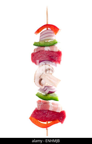 Barbecue skewer, ready for the grill. - Stock Image