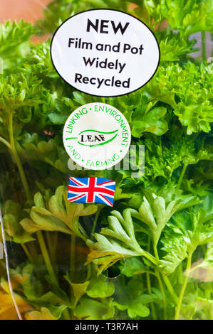 Recycling instructions on pot of Curly Leafed Parsley. With sticker showing grown in the UK & LEAF Marque sticker encouraging sustainable farming. - Stock Image